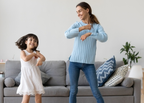 Mom and Daughter Dancing_Financial Article_600x429